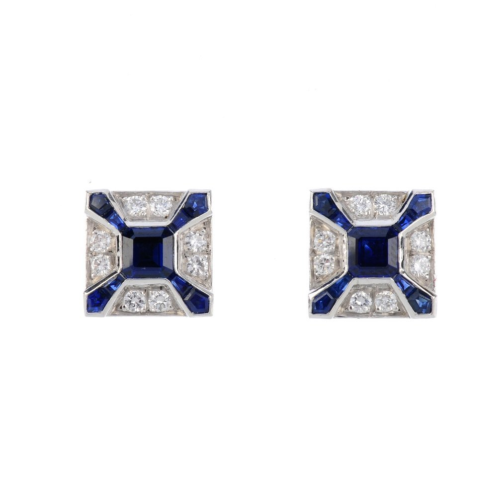 A pair of sapphire and diamond earrings. Each designed