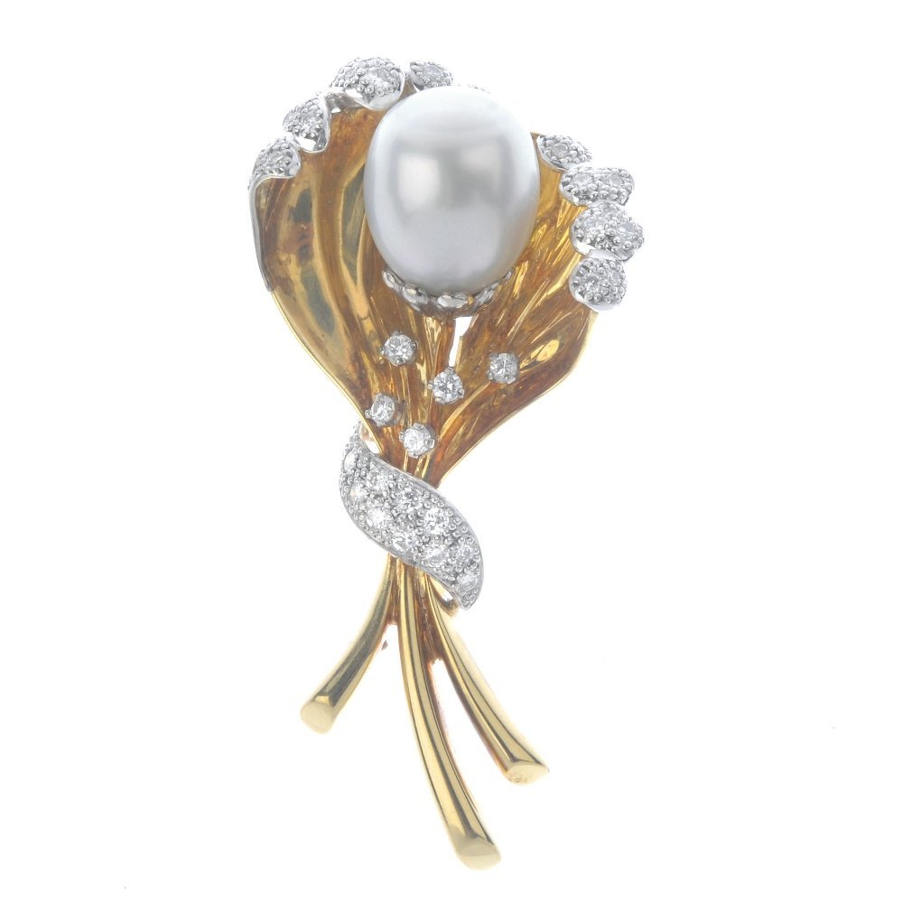 An 18ct gold cultured pearl and diamond brooch. Of