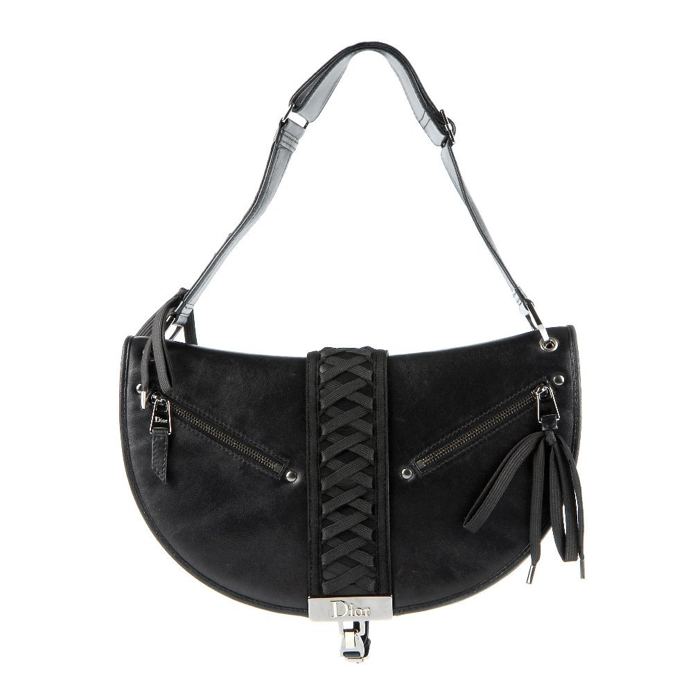 CHRISTIAN DIOR - a black leather braided handbag.