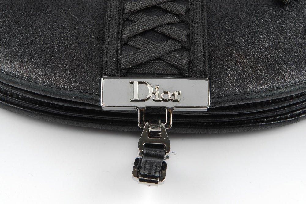 CHRISTIAN DIOR - a black leather braided handbag. - 4