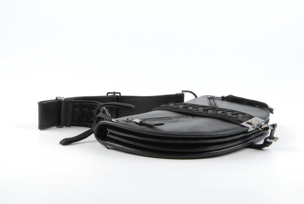 CHRISTIAN DIOR - a black leather braided handbag. - 6