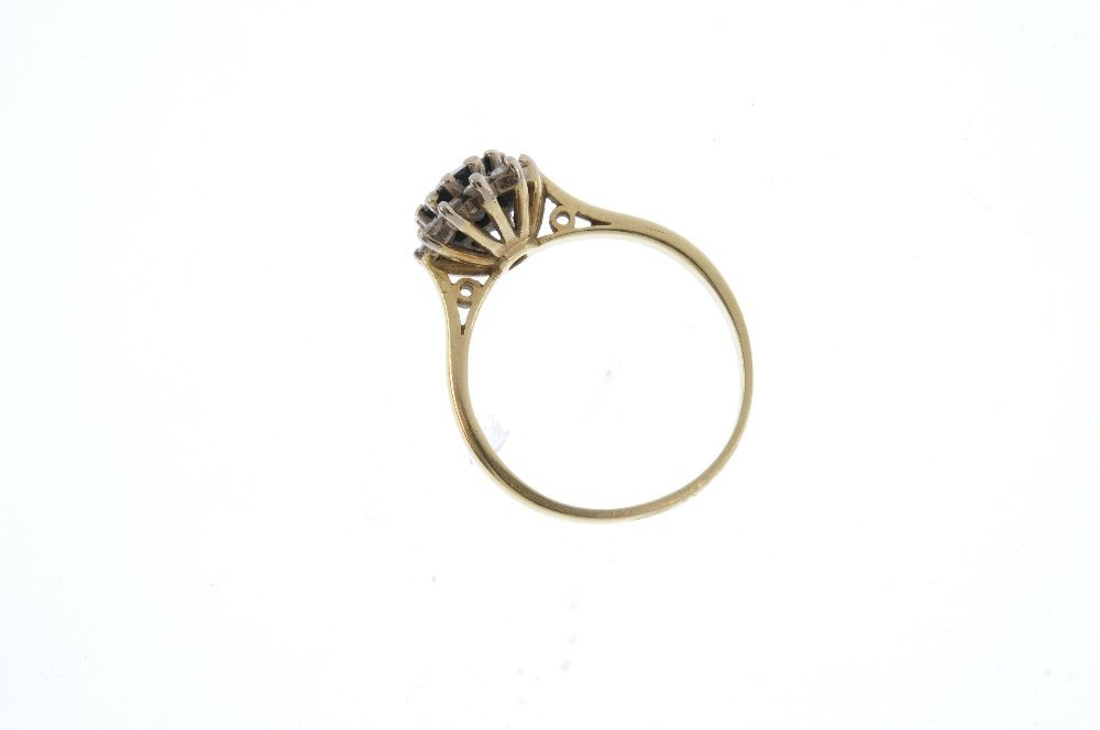 An 18ct gold sapphire and diamond cluster ring. The - 2
