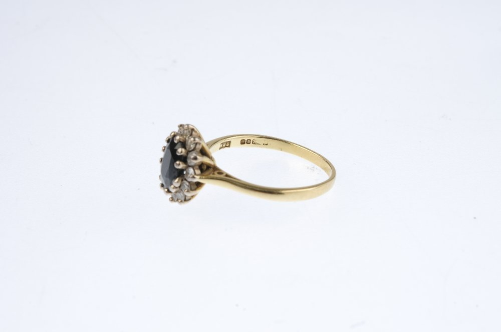 An 18ct gold sapphire and diamond cluster ring. The - 3