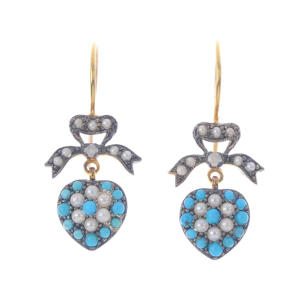 A pair of diamond and gem-set earrings. Each designed
