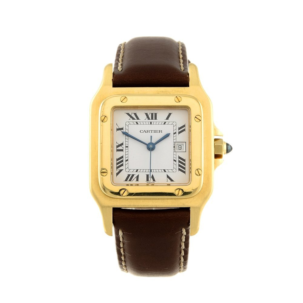 CARTIER - a Santos wrist watch. Yellow metal case,