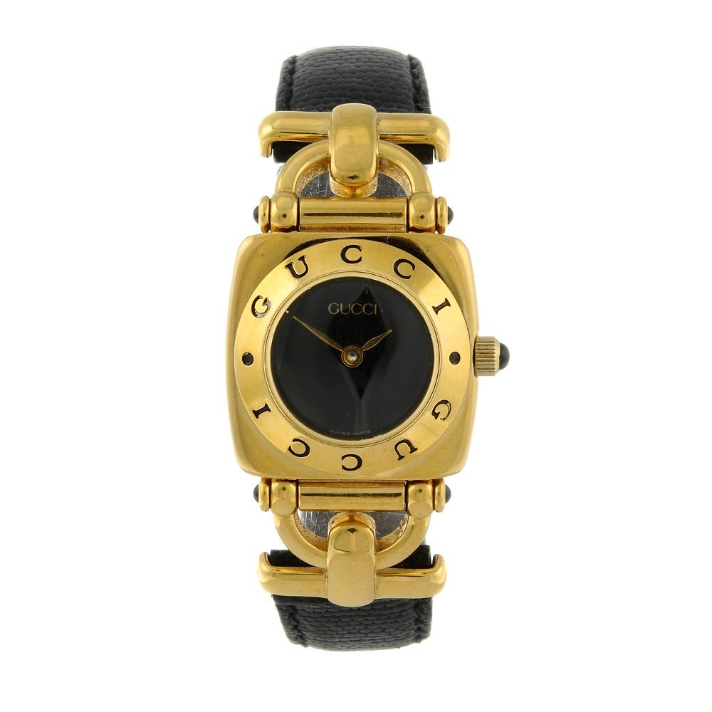 GUCCI - a lady's 6300L wrist watch. Gold plated case.