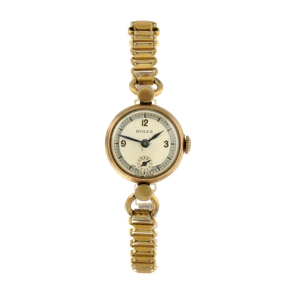 ROLEX - a lady's bracelet watch. 9ct yellow gold case,