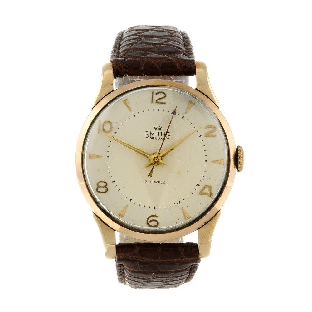 SMITHS - a gentleman's De Luxe wrist watch. 9ct yellow