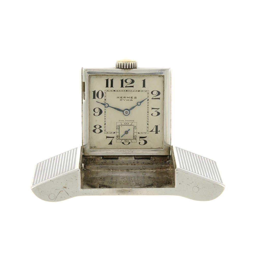 A belt buckle watch by Herms. Continental white metal