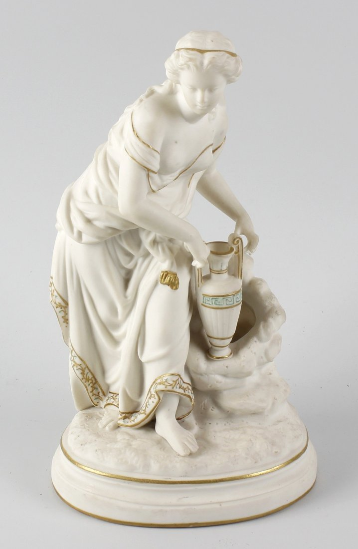 A tinted Parian ware figure with gilt detail, modelled