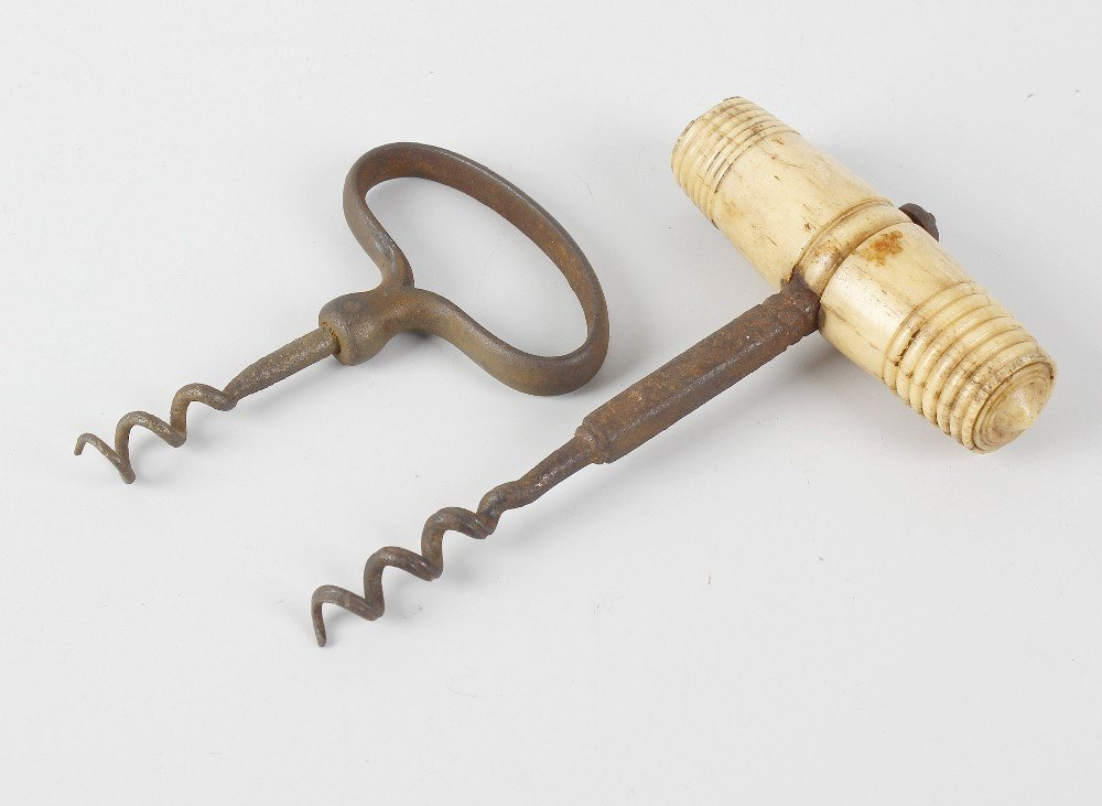 A box containing early 19th century corkscrew, having