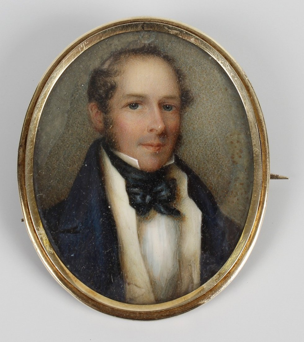 An oval painted portrait miniature on ivory, depicting