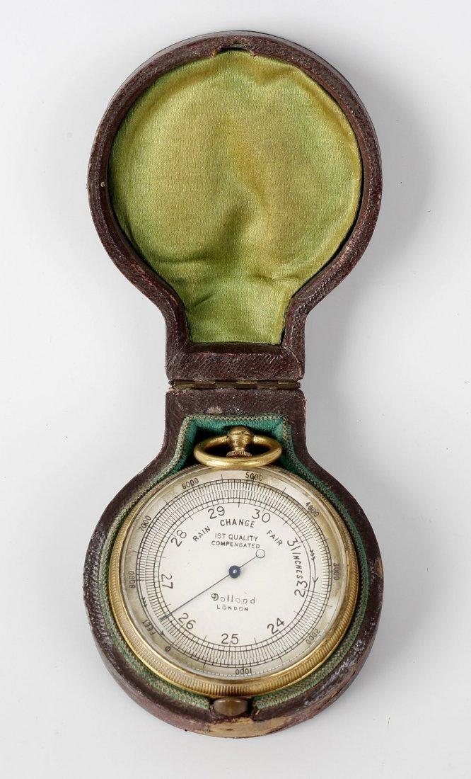 A Dolland of London gilt metal cased pocket barometer,