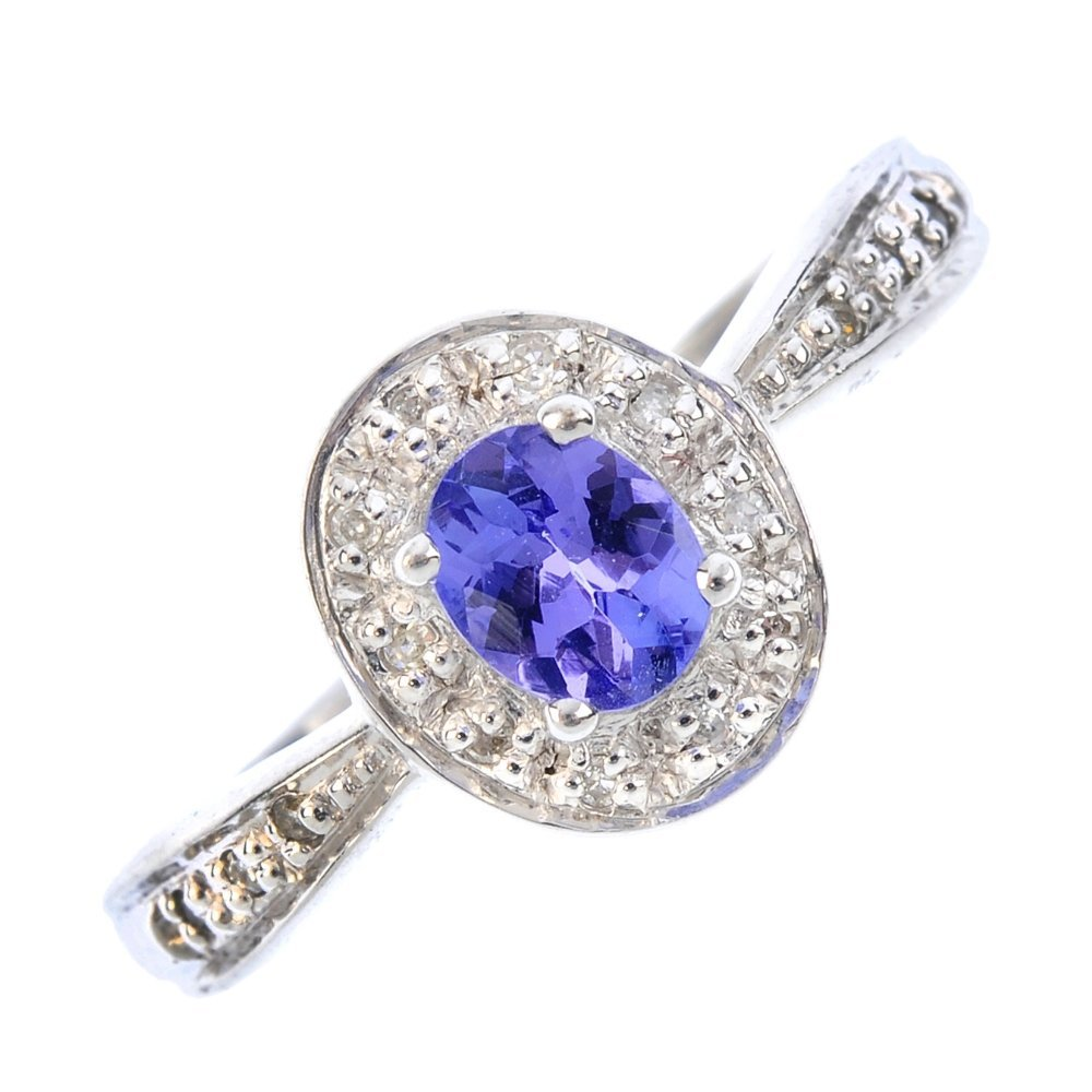 A 9ct gold tanzanite and diamond cluster ring. The
