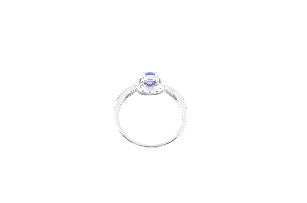 A 9ct gold tanzanite and diamond cluster ring. The - 3