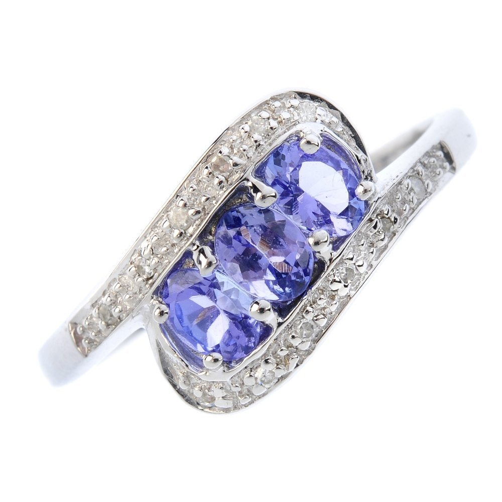 A 9ct gold tanzanite and diamond dress ring. Designed