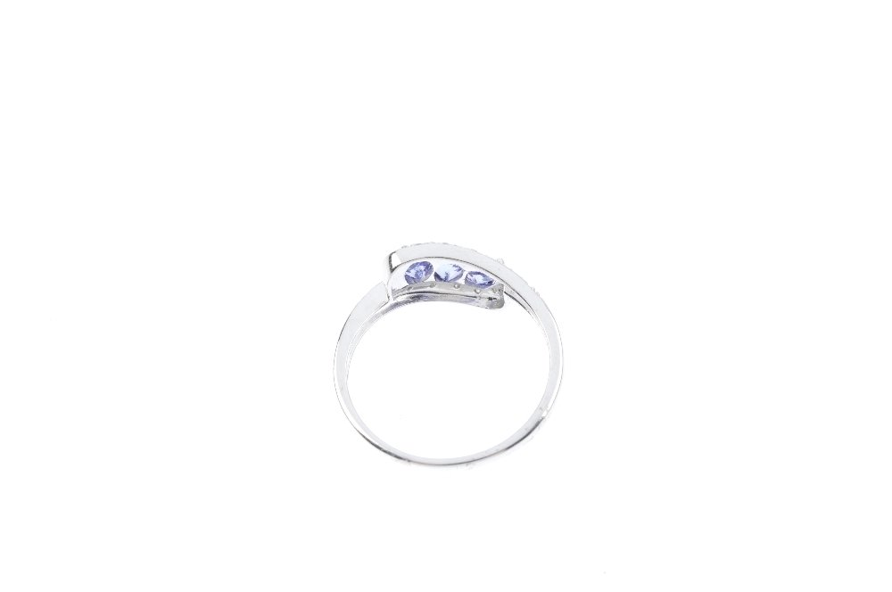 A 9ct gold tanzanite and diamond dress ring. Designed - 3