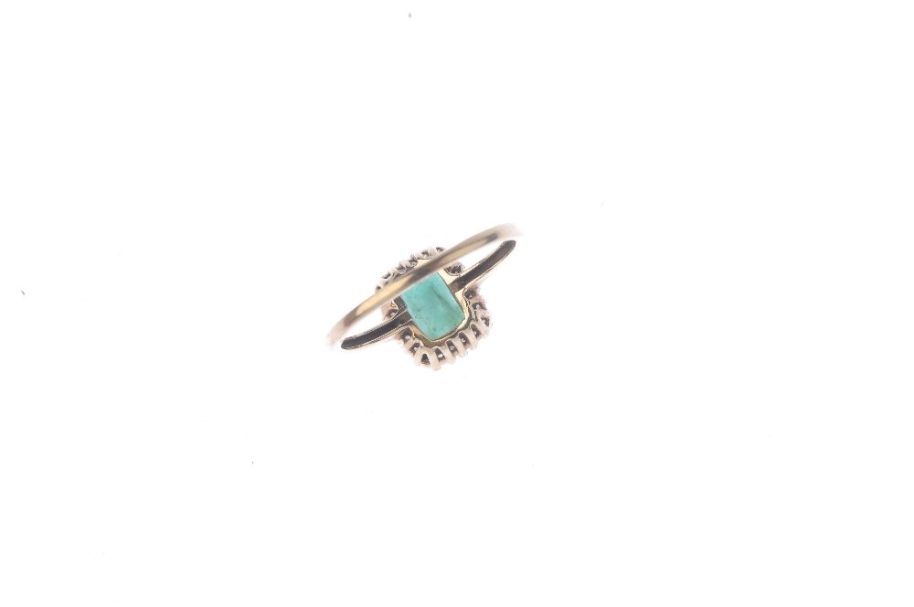 A 9ct gold emerald and diamond cluster ring. The - 2