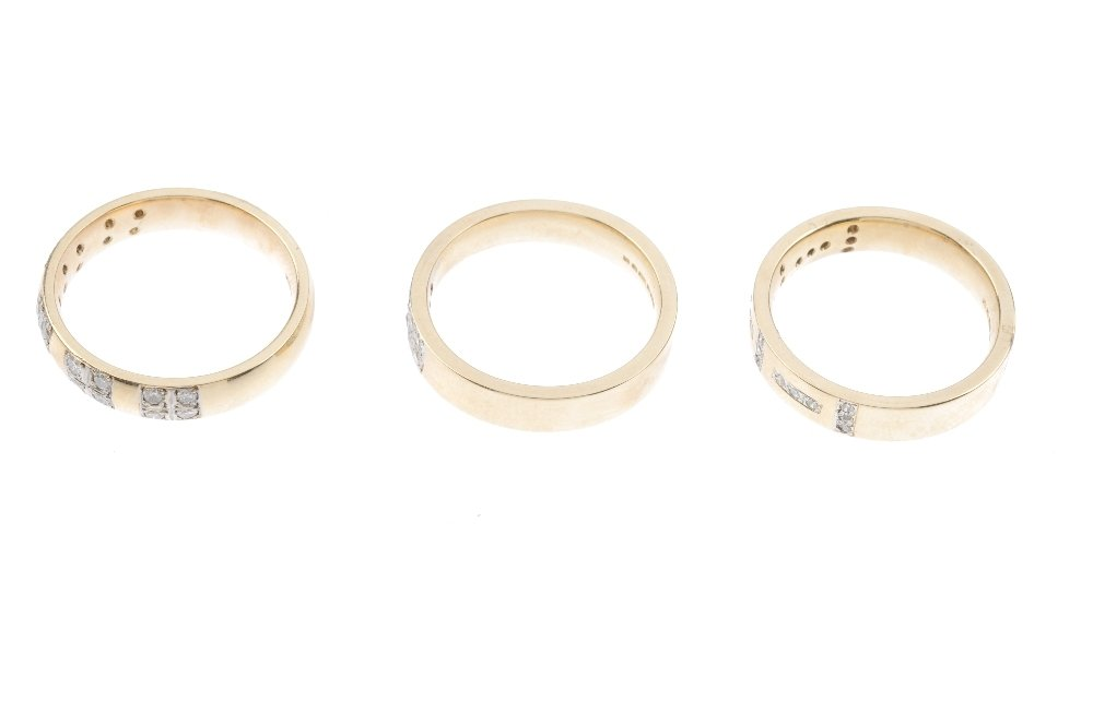 Three 9ct gold diamond band rings. To include a diamond - 2