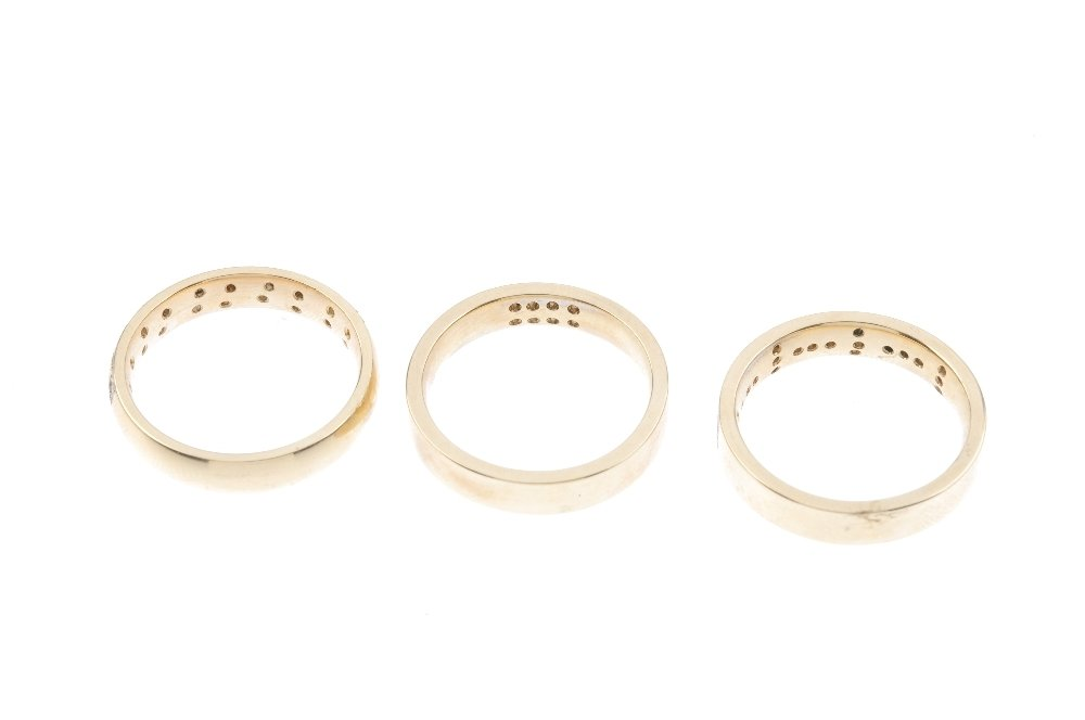 Three 9ct gold diamond band rings. To include a diamond - 3