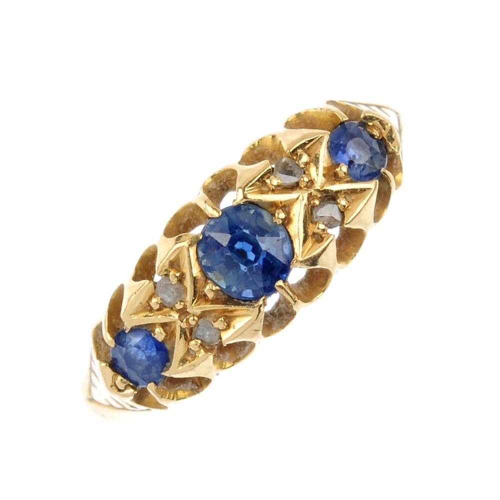 An Edwardian 18ct gold sapphire and diamond ring. The