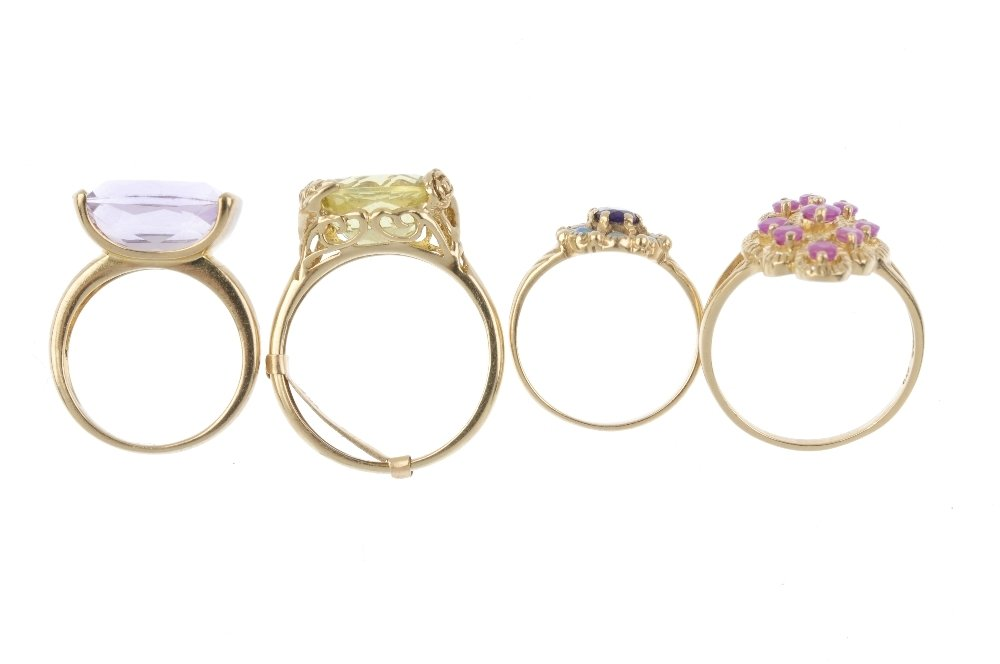Four 9ct gold gem-set rings. To include a ruby panel - 2