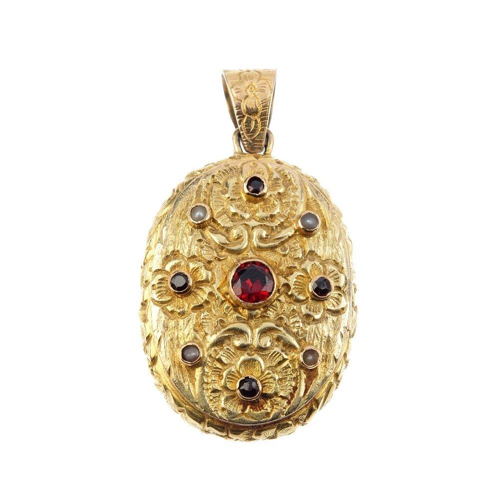A 9ct gold gem-set locket. Of oval-outline, the
