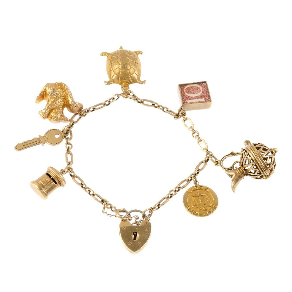 A 9ct gold charm bracelet. The fancy-link bracelet,