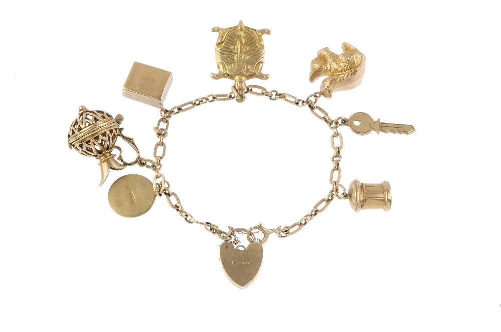 A 9ct gold charm bracelet. The fancy-link bracelet, - 2