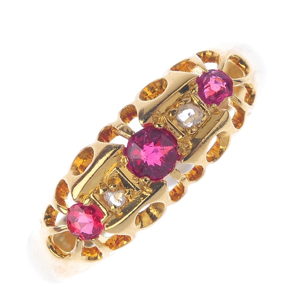 A 1920s 18ct gold ruby and diamond dress ring. The