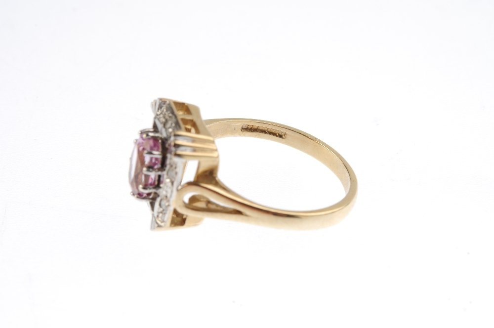 A 9ct gold coated topaz and diamond dress ring. The - 3