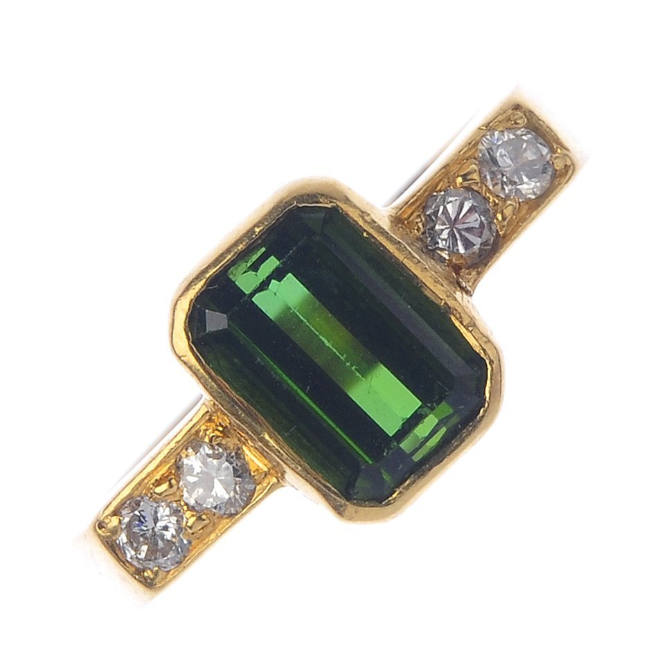 An 18ct gold tourmaline and diamond dress ring. The