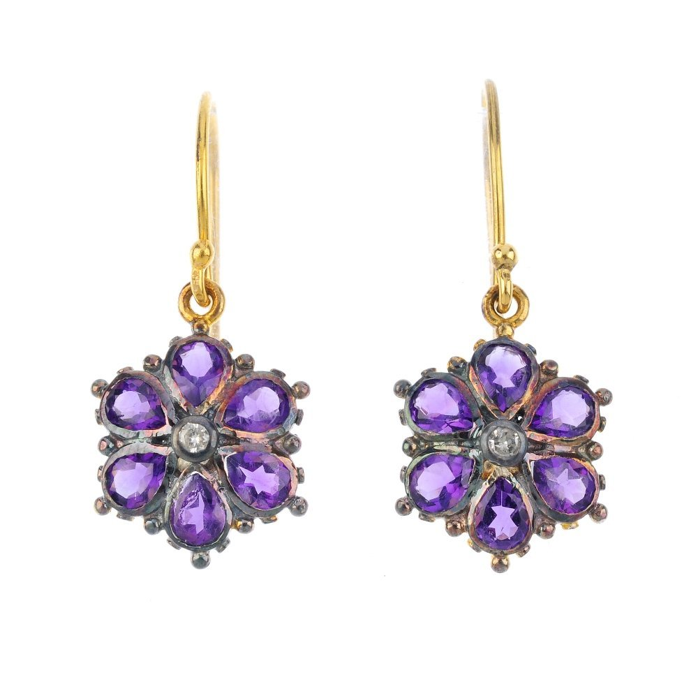 A pair of amethyst and diamond floral earrings. Each