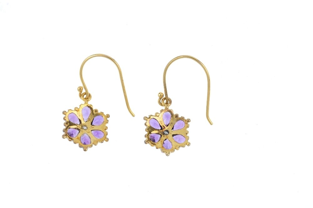 A pair of amethyst and diamond floral earrings. Each - 2