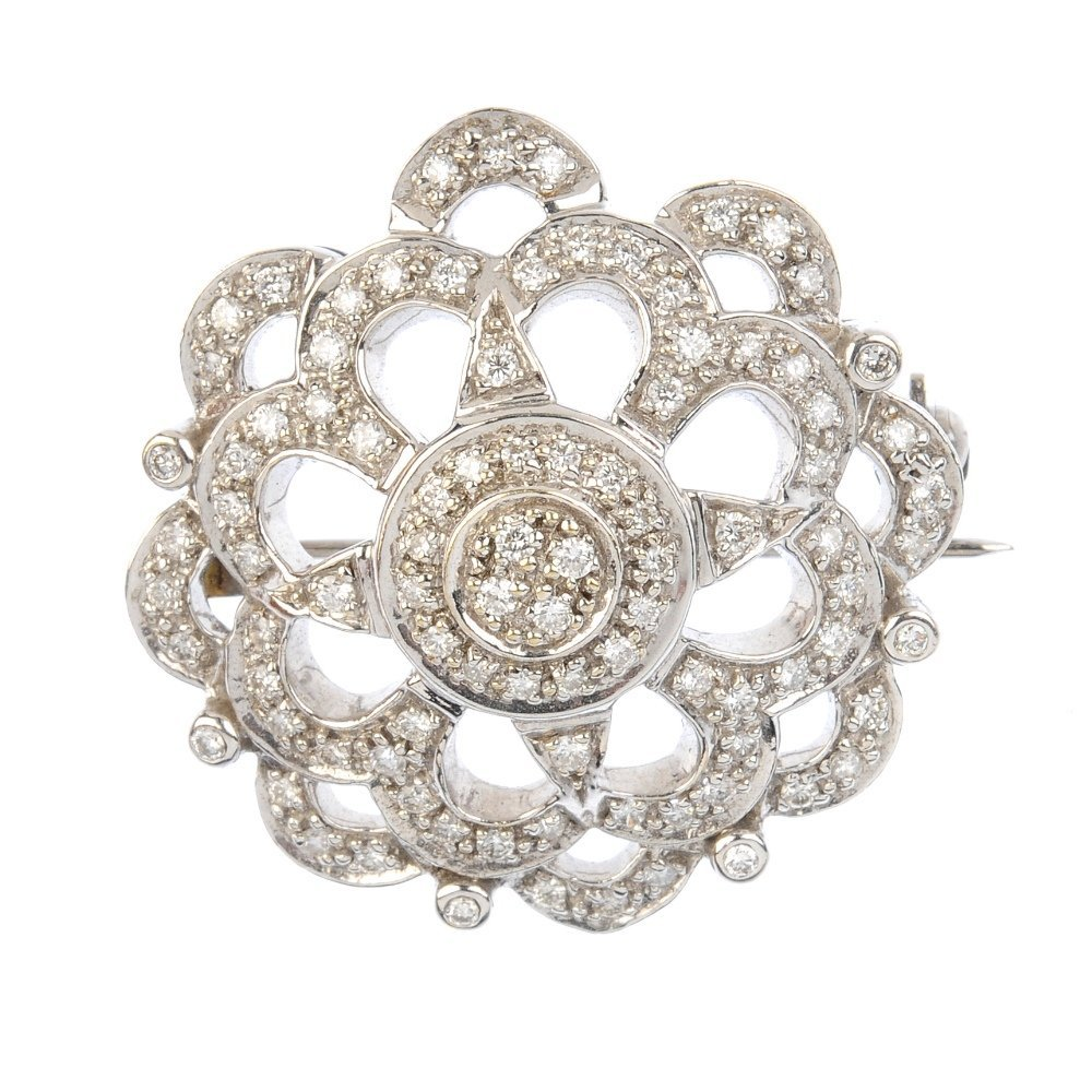 A 9ct gold diamond brooch. The pave-set diamond disc,