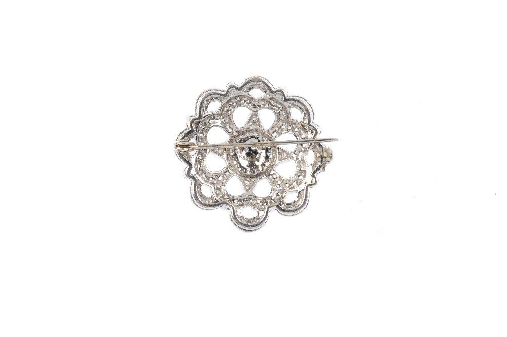 A 9ct gold diamond brooch. The pave-set diamond disc, - 2