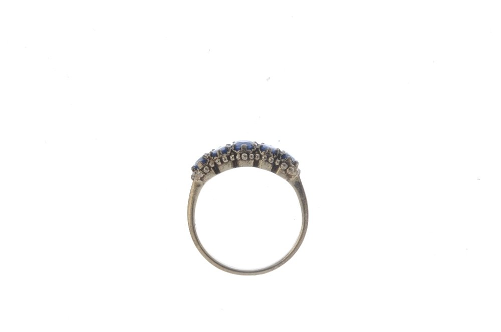 A 9ct gold sapphire five-stone ring. The graduated - 2