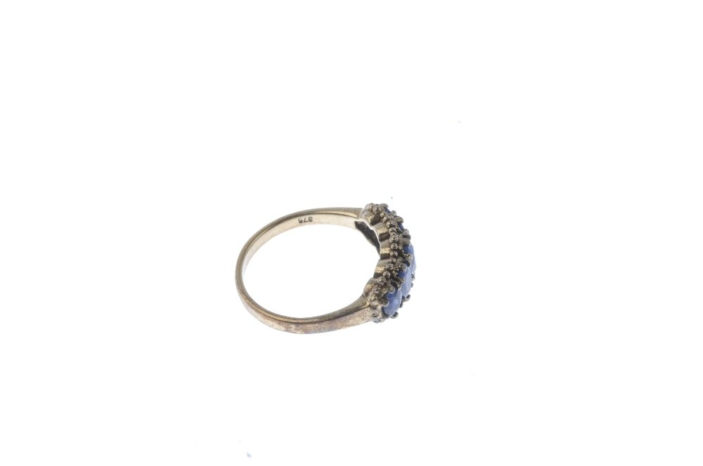 A 9ct gold sapphire five-stone ring. The graduated - 4