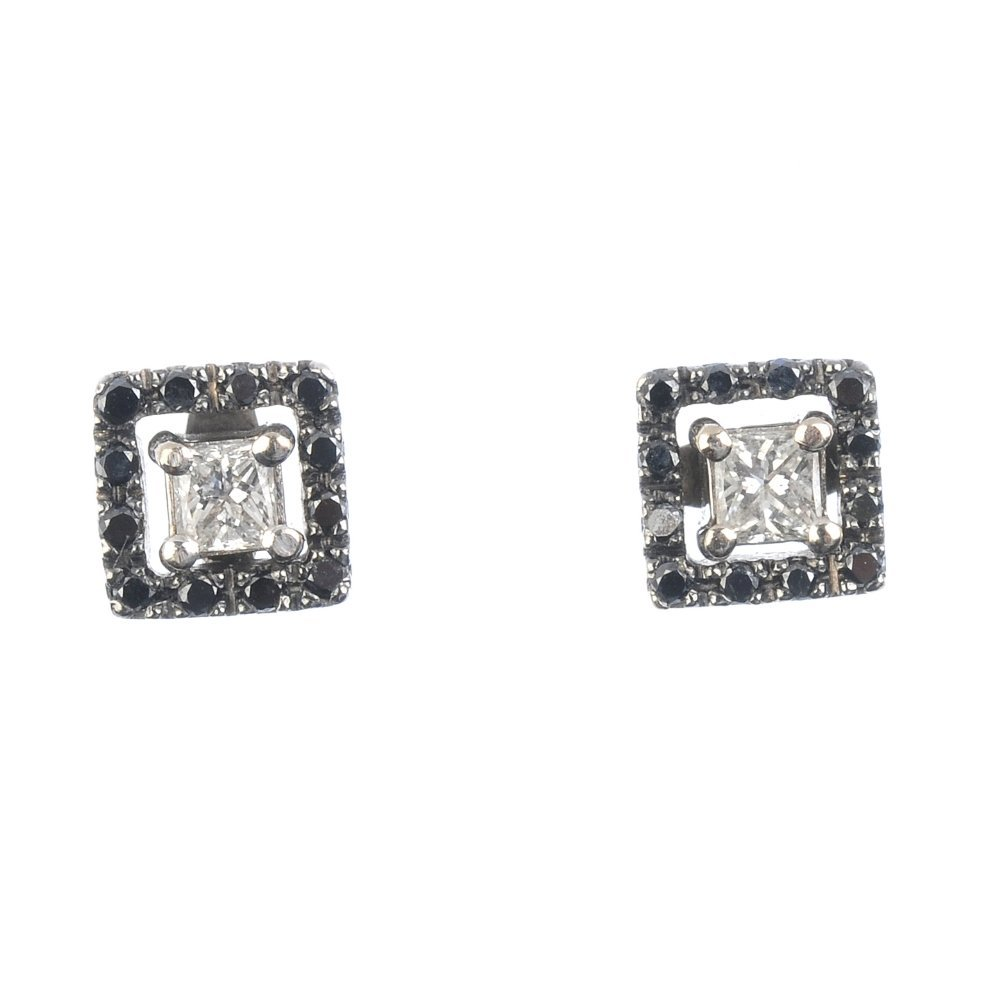 A pair of diamond and gem-set earrings. Each designed