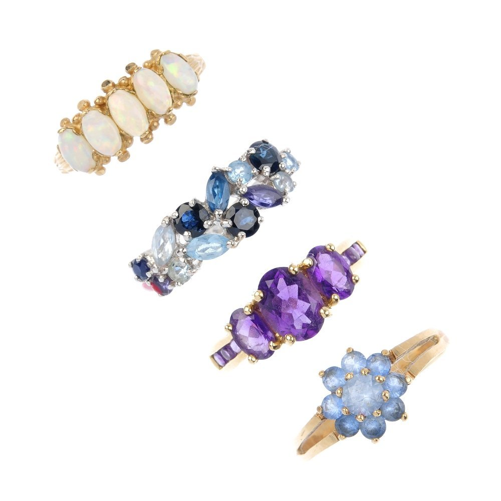 Four 9ct gold gem-set dress rings. To include an oval