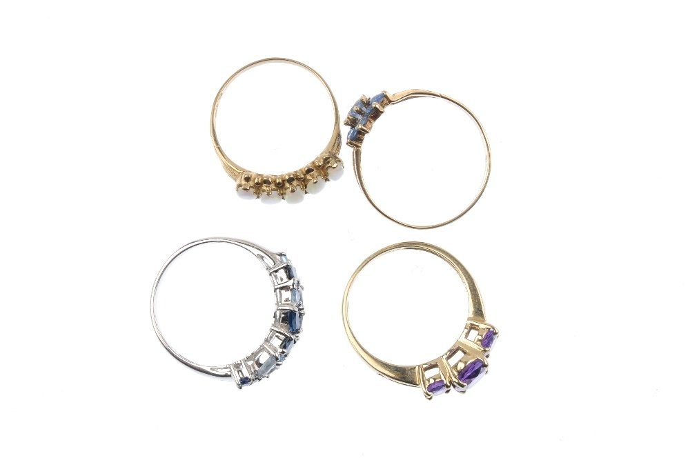 Four 9ct gold gem-set dress rings. To include an oval - 2