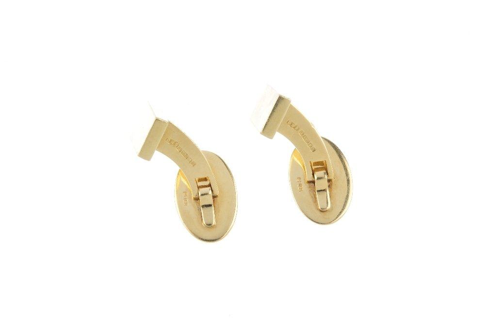 A pair of 18ct gold cufflinks. Each designed as a - 2