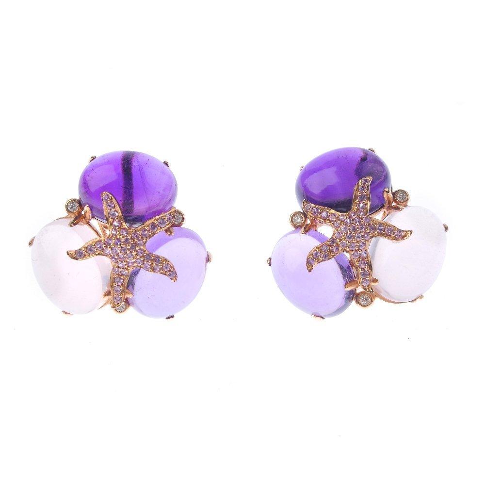 (131366-1-A) A pair of gem-set ear studs. Each designed