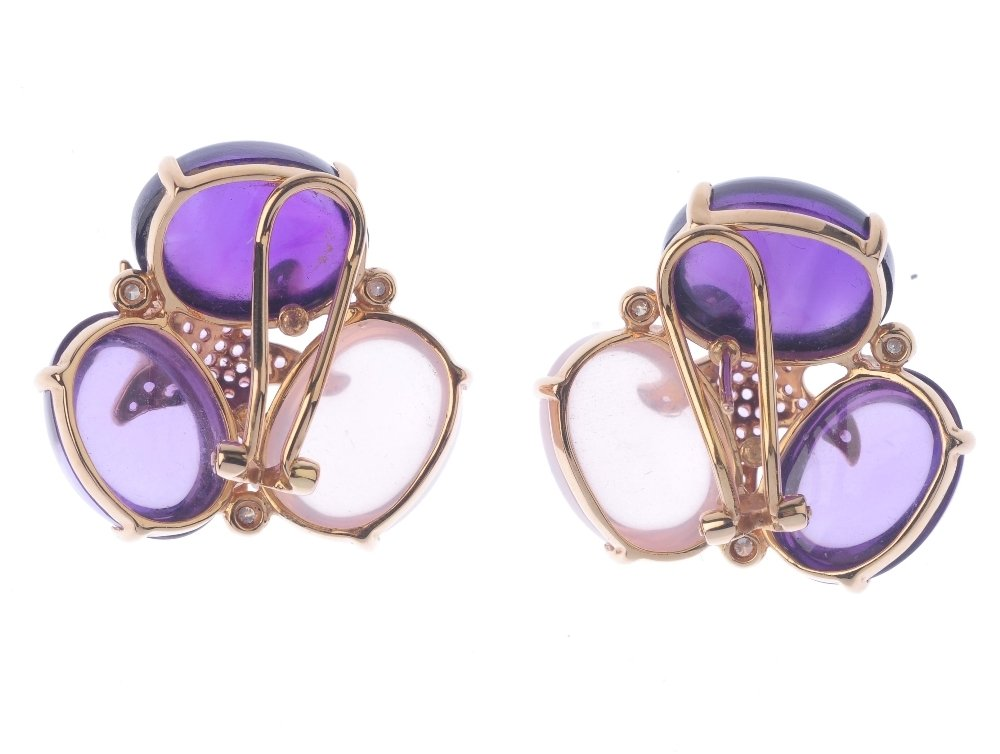 (131366-1-A) A pair of gem-set ear studs. Each designed - 2