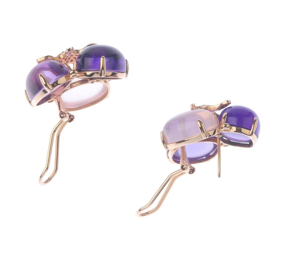 (131366-1-A) A pair of gem-set ear studs. Each designed - 3