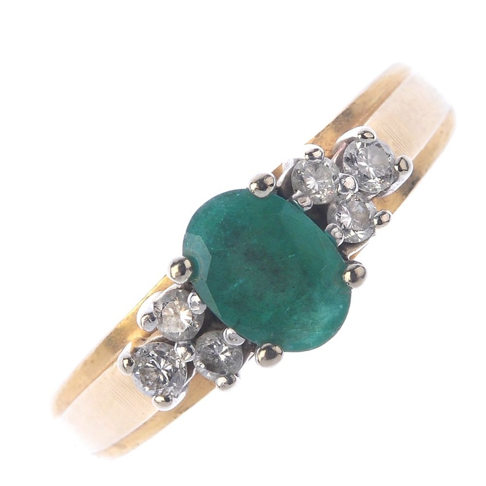(401754-7-A) An emerald and diamond ring. The
