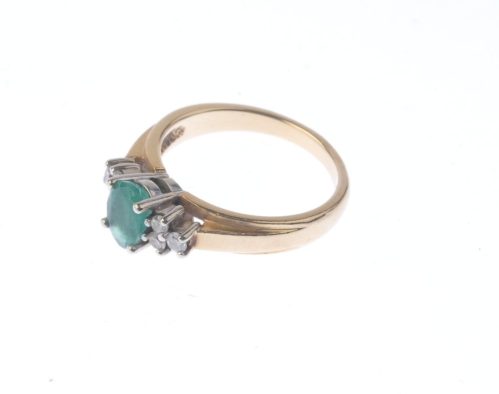 (401754-7-A) An emerald and diamond ring. The - 4