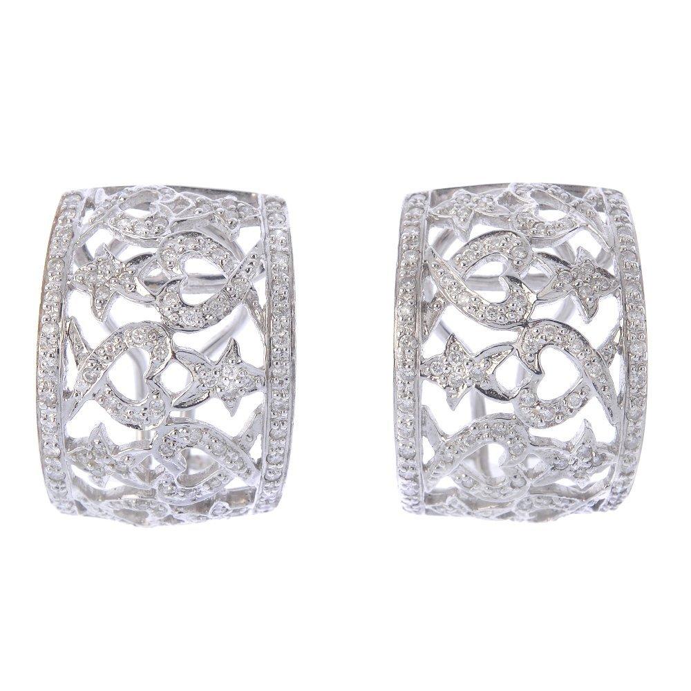 (203799) A pair of diamond earrings. Each designed as a
