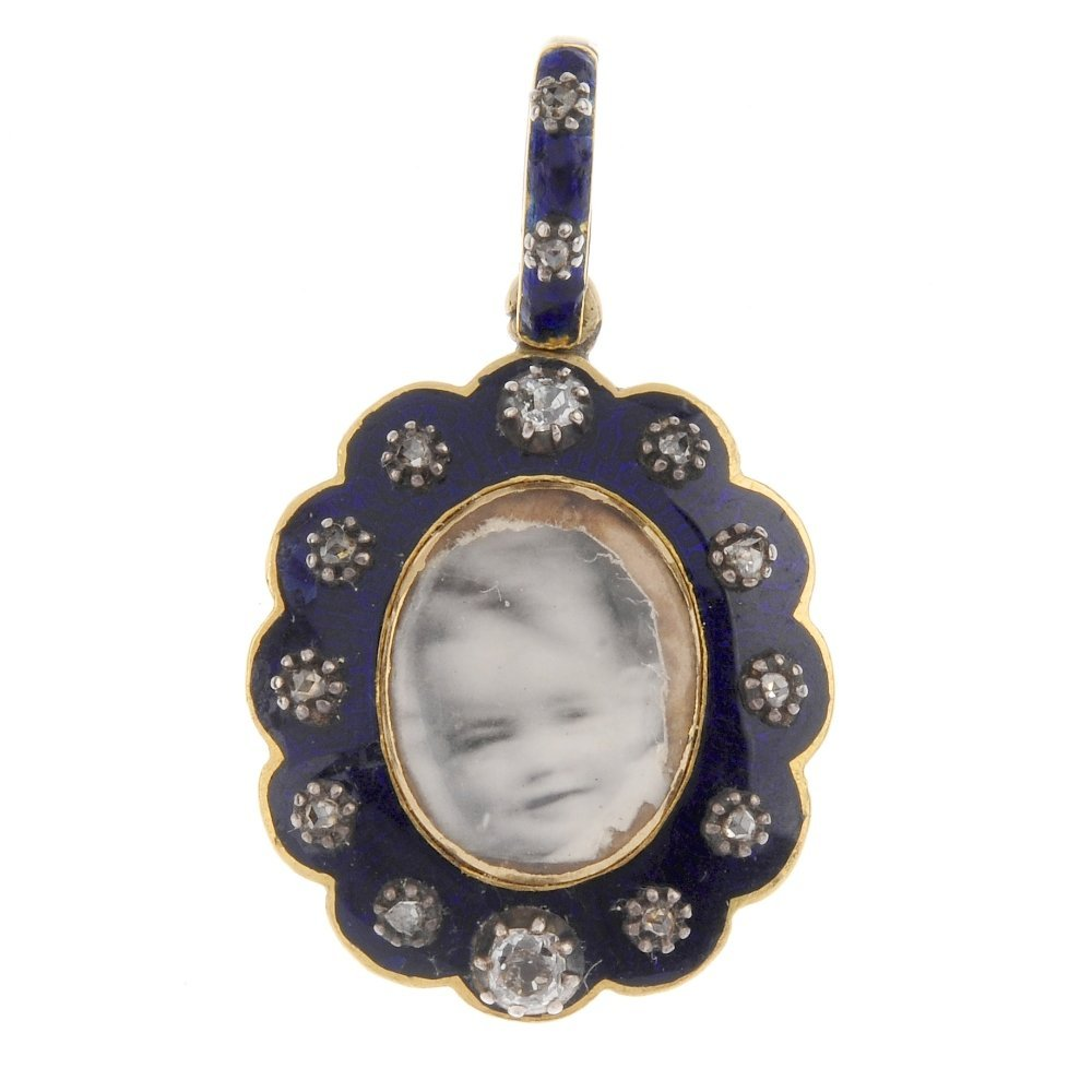 A mid Victorian enamel and diamond photograph pendant.