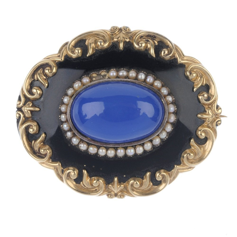 A mid Victorian enamel and gem-set memorial brooch. The